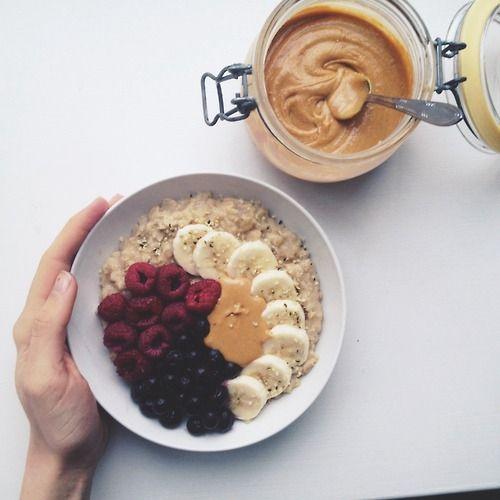 Vanilla Maca Oatmeal + banana + blueberries + raspberries + peanut butter